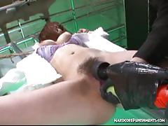 Bound asian gets her hairy pussy tormented