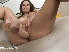 Scorching babe toys her warm pussy