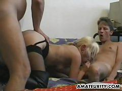 Racy blonde spit roasted in threesome