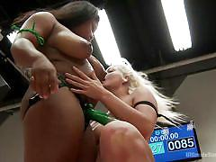 Hot blonde lesbian sucking strap on