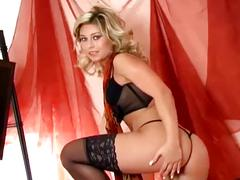 Sexy babe strips and fingers her shaved pussy
