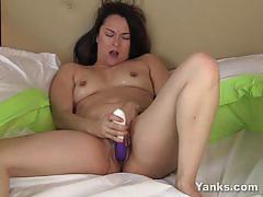 Sumptuous brunette toys her moist pussy