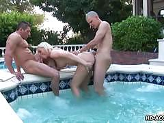 Fucking a blonde babe by the pool