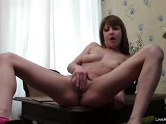 Beautiful brown haired girl masturbates on cam