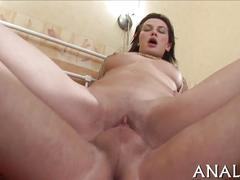 Wild russian chick gets fucked by an acrobat in bed