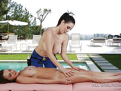 Busty skillful milf massaging a hot brunette