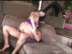 Brunette tattooed whore gets her ass nailed on the couch