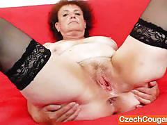 Mature amateur toys her hairy pussy