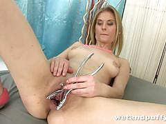 Naughty blonde toys her warm slot