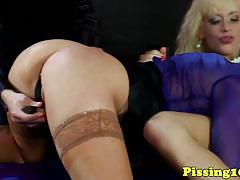 Piss drenched babes enjoy lesbian fun