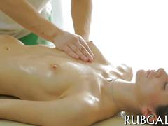 Teen massaged by a seductive masseur into oral sex