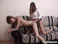 Racy lesbian fists her partners moist pussy