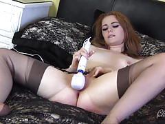Seductive babe loves teasing her moist pussy