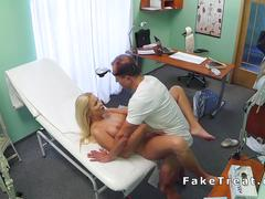 Doctor fucks sexy busty blonde in a fake hospital
