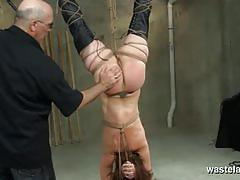 Bound brunette spanked