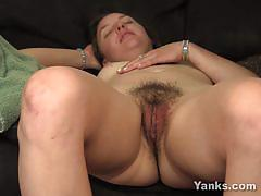 Racy amateur exposes her round ass