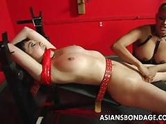 Horny lesbian couple in a steamy bondage session