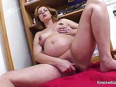 Pregnant amateur plays with her moist slot