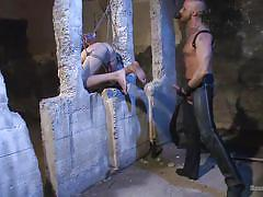 Slave is tied to concrete, hanged with rope and whipped