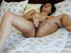 Kinky gaga fingers her hairy pussy