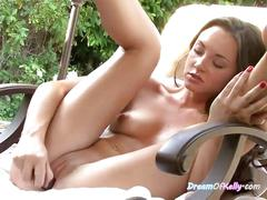 Beautiful kelly trashes about her pussy in the pool chair
