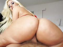 Blondie fesser rides cock in a sexy red bikini