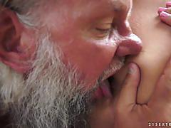 Stunning brunette rides an old man cock in her tight pussy