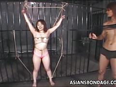 Tiny asian babe gets bondage tease