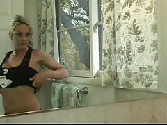 Blonde woman masturbates in the bathroom