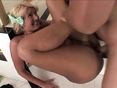 Sluty blonde mature gets fucked in the washroom.