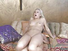 Goldie sucks a dildo and rides it hard