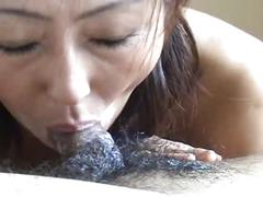 Asian mature sucking down a hairy and foamy dick closeup