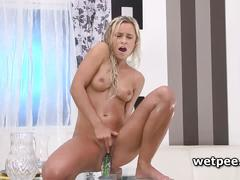 Dido angel rides dildo and pisses on table