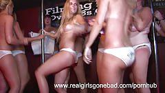 Hot college girls stripping on stage for a wet t-shirt contest