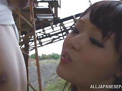 Hot japanese slut gives a blowjob outdoors