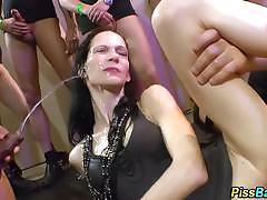 Piss drenched brunette enjoy group fuck