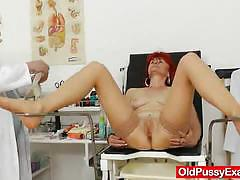 Mature redhead gets her pussy examined