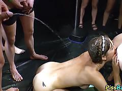 Piss drenched brunette gets her slippery throat slammed