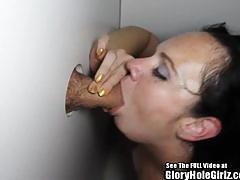 Brunette babe sucking dick in glory hole