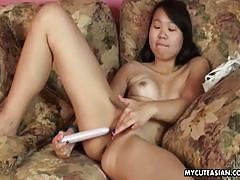 Japanese babe toys her moist pussy