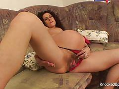 Pregnant amateur toys her hairy pussy