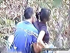 Amateur couple sneakily make out in the park