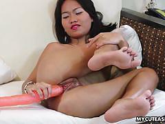 Asian amateur dildo fucks her moist slot