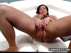 Busty milf masturbates with a dildo