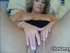 Mother plays with her pussy up close