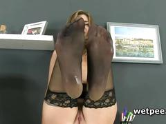 Charlotte pees on her stockings at work