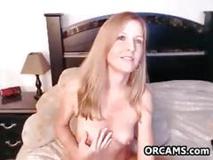 Pretty red haired mother using toys