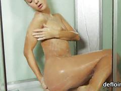 Cute nymph stretches wet cunt and gets deflorated