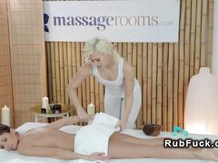 Oiled brunette gets pussy massaged