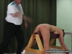 Dominating couple spanking their sub